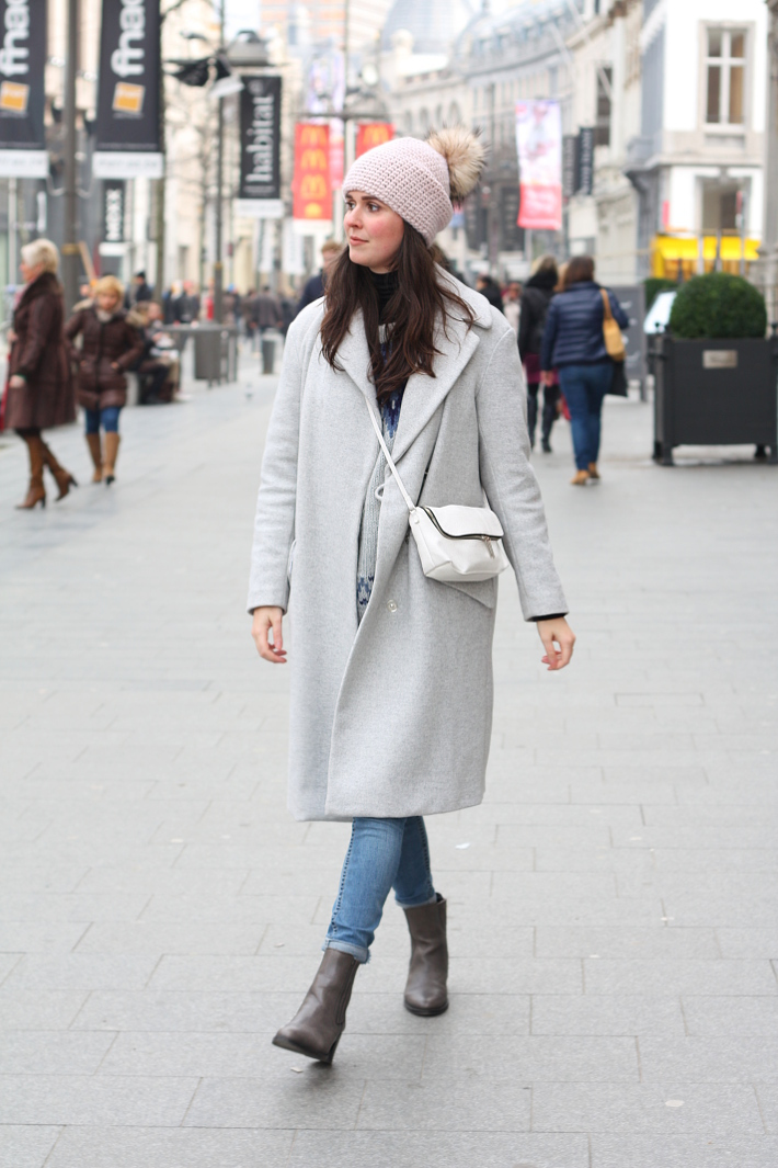 warm winter outfit: grey wool winter coat, pom pom hat, chelsea boots