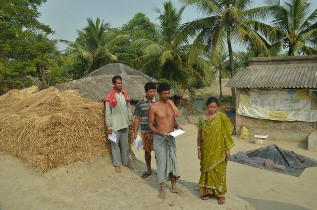 Jitendra Mondal (holding a paper) with his wife and brothers in Hetalbari. The three brothers received a combined compensation of Rs 840