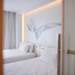 filter blur,The atmosphere of the white room 4 star hotel.with background on the wall  and twin bed
