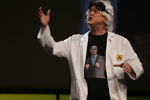 Mad Scientist wearing his lab coat over a Carl Bass Tee Shirt on stage at AU 2014