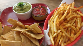 Fries, chips, guac and salsa at Trippy Taco