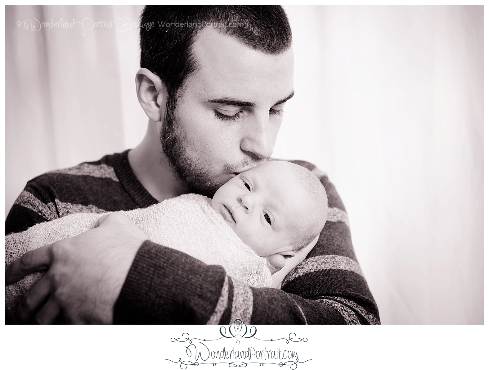 Dad and baby pose Newborn Photos Bucks County PA | WonderlandPortrait.com