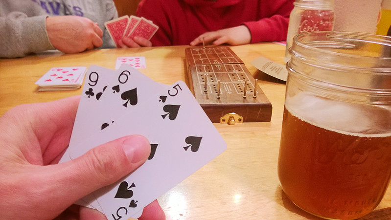 day 3822:  getting trounced by kris and odin while playing cribbage at the driftless cafe.