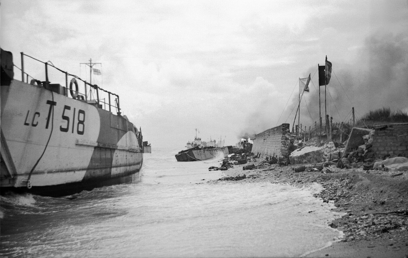 Wrecked landing craft on Nan Red beach, Juno area, at St Aubin-sur-Mer, 6 June 1944.