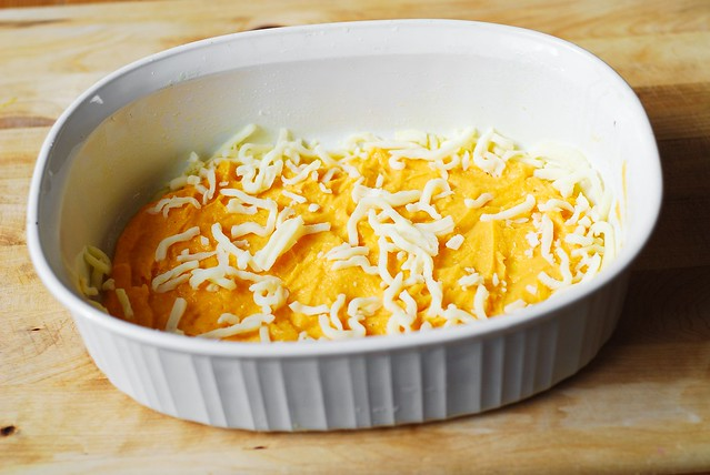 Spread butternut squash puree over the bottom of the baking pan, then sprinkle some Mozzarella cheese on top