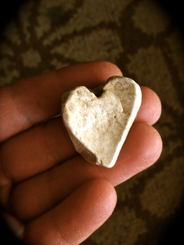 a picture of heart shaped rock held in a hand