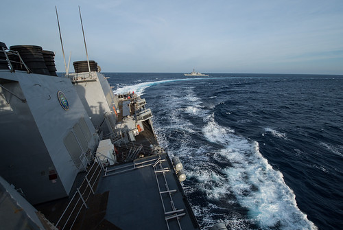 USS Donald Cook (DDG 75) makes a hard turn after completing a passenger transfer.