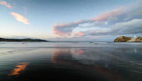 light sunset newzealand sky lighthouse water clouds sand dusk tide castlepoint wairarapa