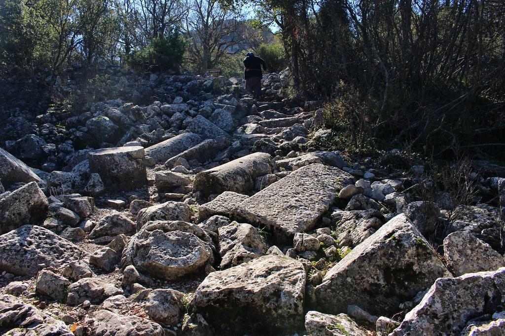 Grandma climbing ruins