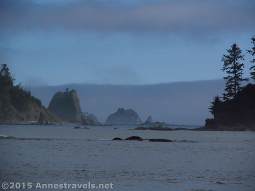 The sun begins to appear on the sea stack south of Third Beach, Olympic National Park, Washington