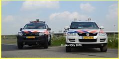 Dutch KMAR and Police.