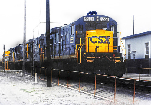 CSX GE B30-7 locomotive # 5551 and other GE locomotives are passing through the washer at Uceta Yard in Tampa, Florida, August 1991