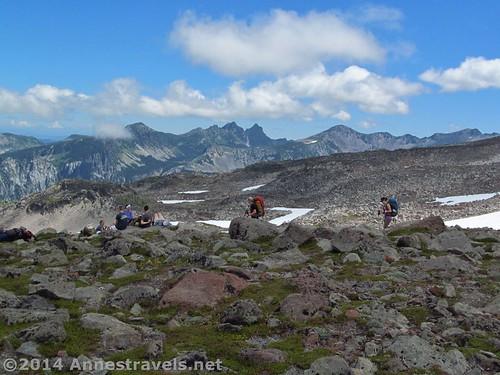 Hikers on the top of the hill above Spray Park, Mt. Rainier National Park, Washington