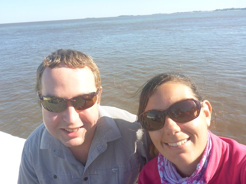 Us in front of the brown river