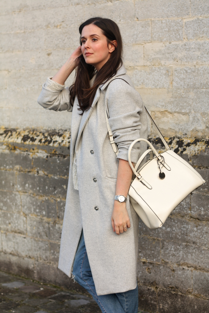 long coat white purse boyfriend jeans outfit