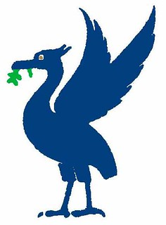 BLUE_LIVERBIRD_with_green_leaf