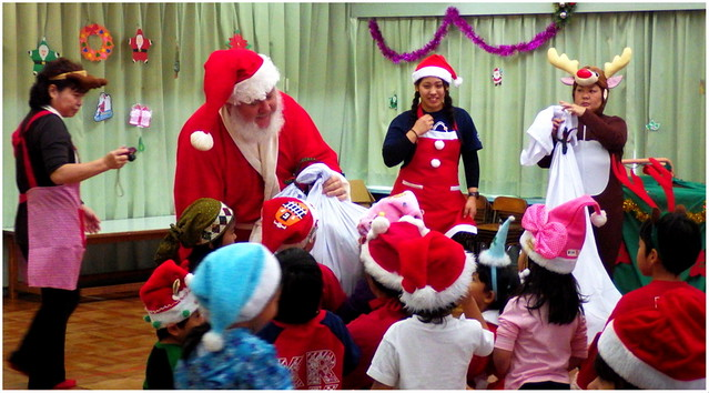 OLD SOBA, er... SANTA CLAUS -- HANDING OUT GIFTS TO CHILDREN AT A LOCAL KINDERGARTEN