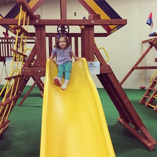 The swing set showroom turns into an indoor playground during the week. So smart!