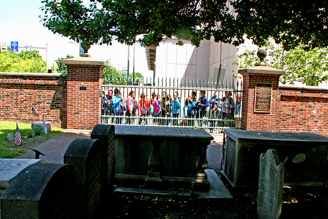 Schoolchildren looking through fence at the grave of Benjamin Franklin, Christ Church Burial Grounds, Philadelphia