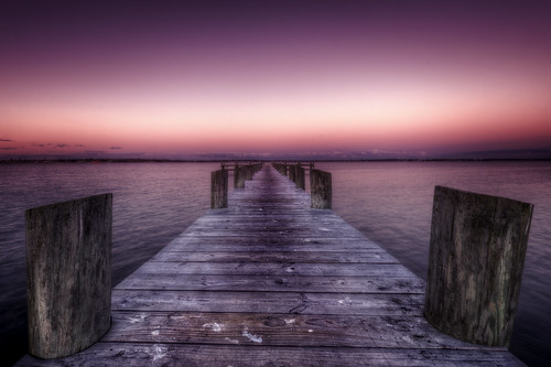 ocean light sunset sea seagulls pier dock purple unitedstates massachusetts magenta newengland droppings buzzardsbay newbedford davyslocker trigphotography frankcgrace