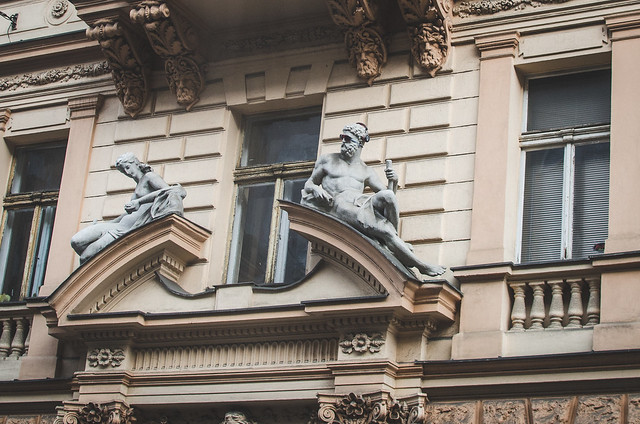 Classic Prague architecture is jazzed up with a pair of sunglasses and headphones.