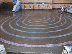 outdoor structure(0.0), sport venue(0.0), baseball field(0.0), race track(0.0), walkway(0.0), flooring(0.0), stadium(0.0), arena(0.0), floor(1.0), labyrinth(1.0), road surface(1.0),