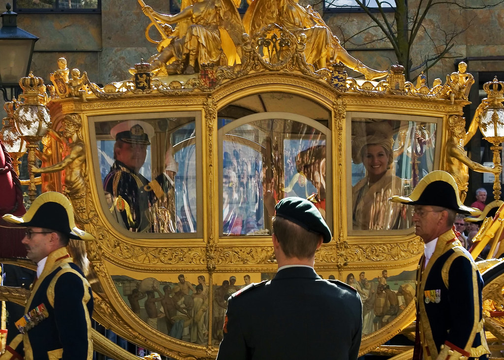The Gold Coach with Prince Willem-Alexander, Queen Beatrix, and Princess Máxima. Credit Toni