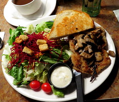 Veal Cutlet with salad and garlic bread