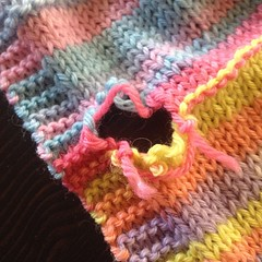 Sniff. Teagan's #scarf I #knit last year with #adriafil #knitcol came out of the wash this way. #hole. :(