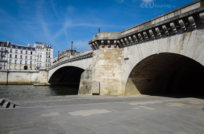 Along the length of the Pont de la Tournelle