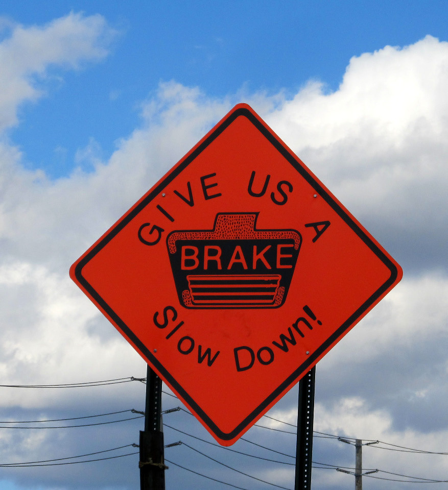 GIVE US A BRAKE Slow Down!