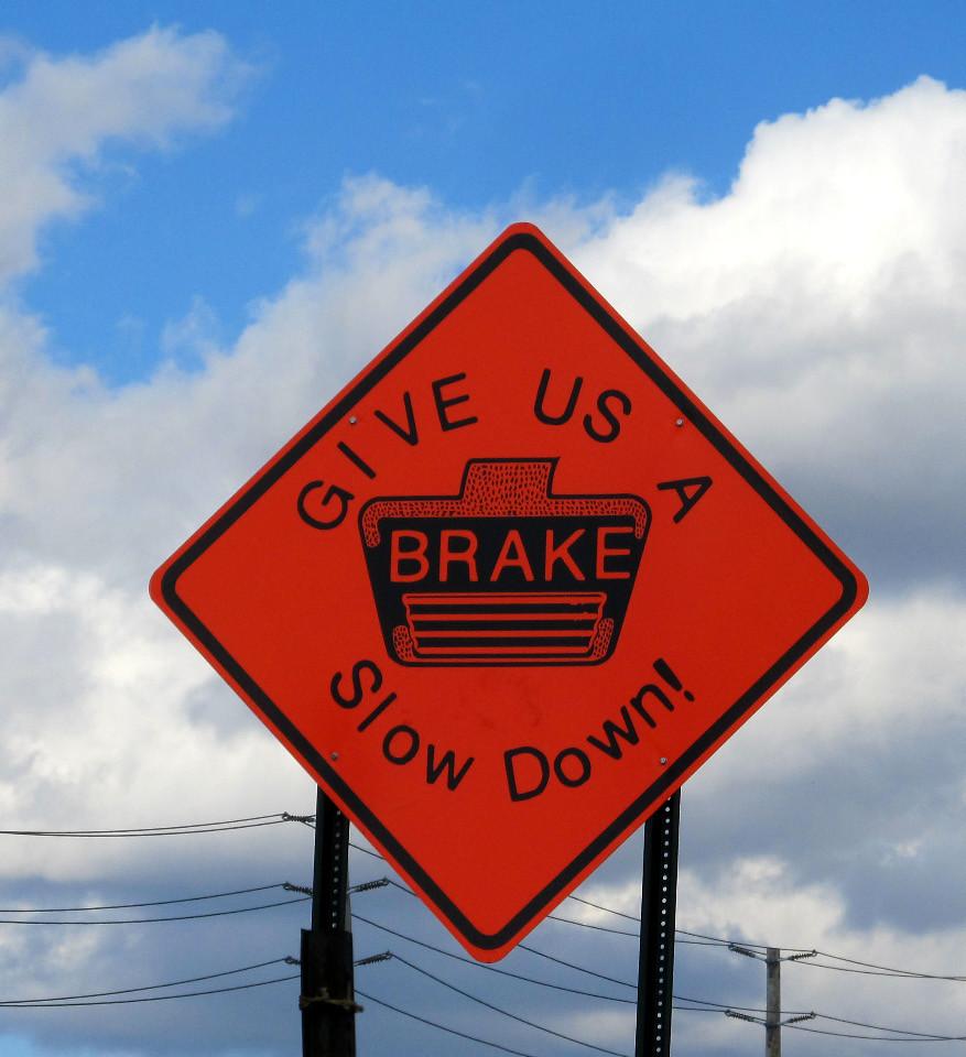 GIVE US A BRAKE Slow Down!