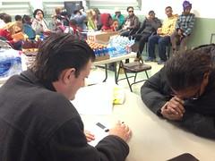 Pastor Chris praying for a recipient