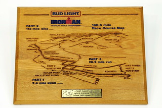 Sun, 11/23/2014 - 14:36 - I only have two, maybe three trophies left from the twenty years that I competed in Kona. This one is the coolest. It's a laser-engraved map of the course in hardwood. Of course, there was no prize money for the event in 1985.
