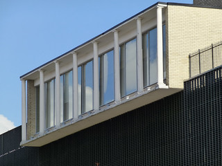 somebody thought adding badly proportioned Doric columns to a Modern building would look good