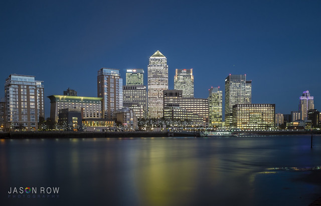 Early evening view of Canary Wharf London taken from the opposite bank of the river Thames.