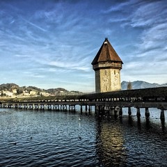 The Kapellbrücke (literally, Chapel Bridge) is a covered wooden footbridge spanning diagonally across the Reuss River in the city of Lucerne in central Switzerland.
