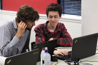 Student demonstrates to his Piwik mentor what he has been working on to improve accessibility. Photo by Kristina Hoeppner