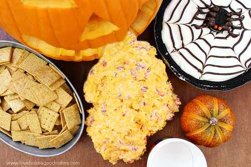 Halloween Snacks: Pumpkin Puke {aka Pimiento Cheese Dip} with Wheat Thins and a pumpkin.