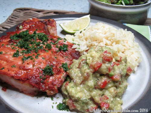 ©Pork chops in Mexican Adobo with guacamole, rice and salad
