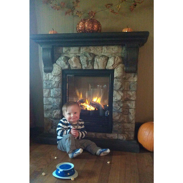 We got an awesome new fireplace and can't keep Liam away from it!