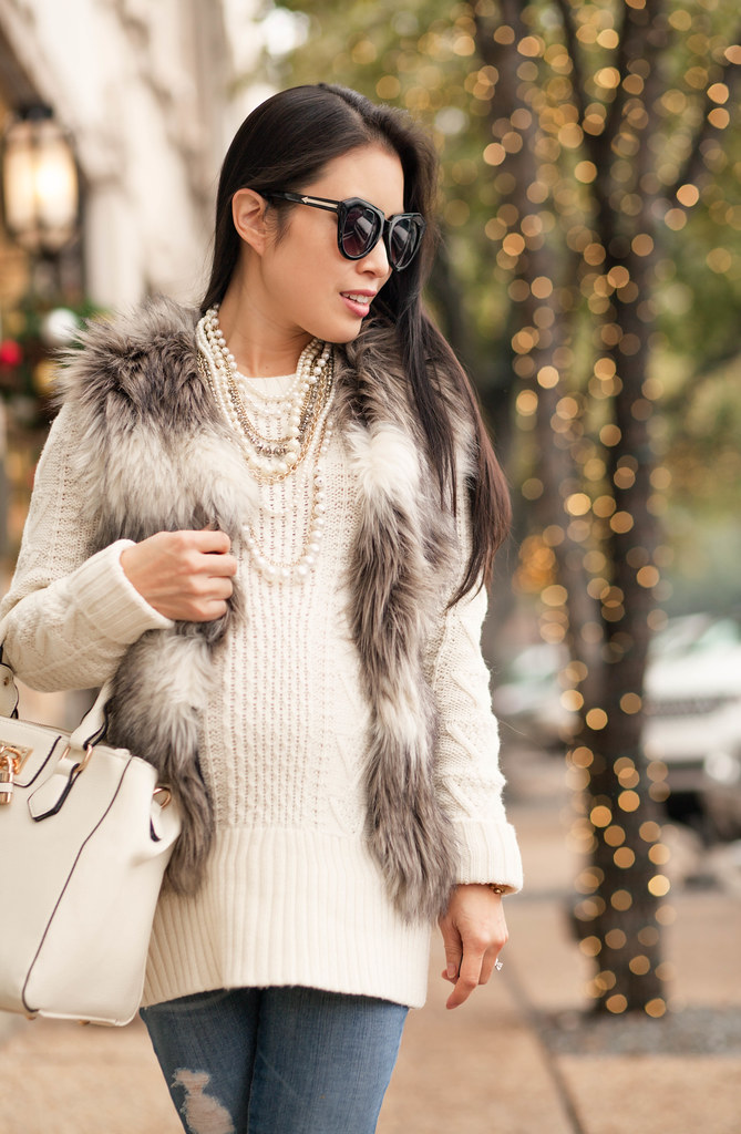 cute & little blog | petite fashion | #maternity #bumpstyle #thirdtrimester | chicwish striped faux fur vest, white cable knit sweater, ag distressed jeans, pearl layered necklace, white lock satchel | fall winter outfit