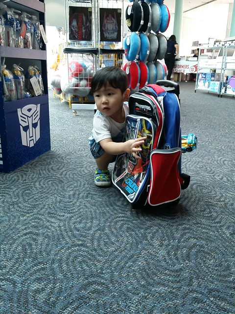 Jerome clutching onto a Transformers Bag, refusing to