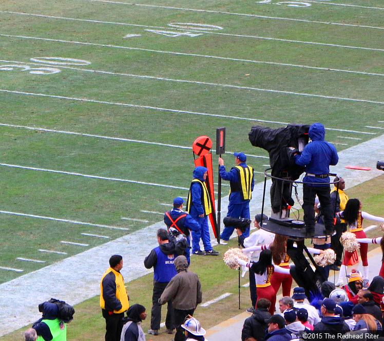 24 cameramen put raincoats on cameras dallas cowboys vs washington redskins game