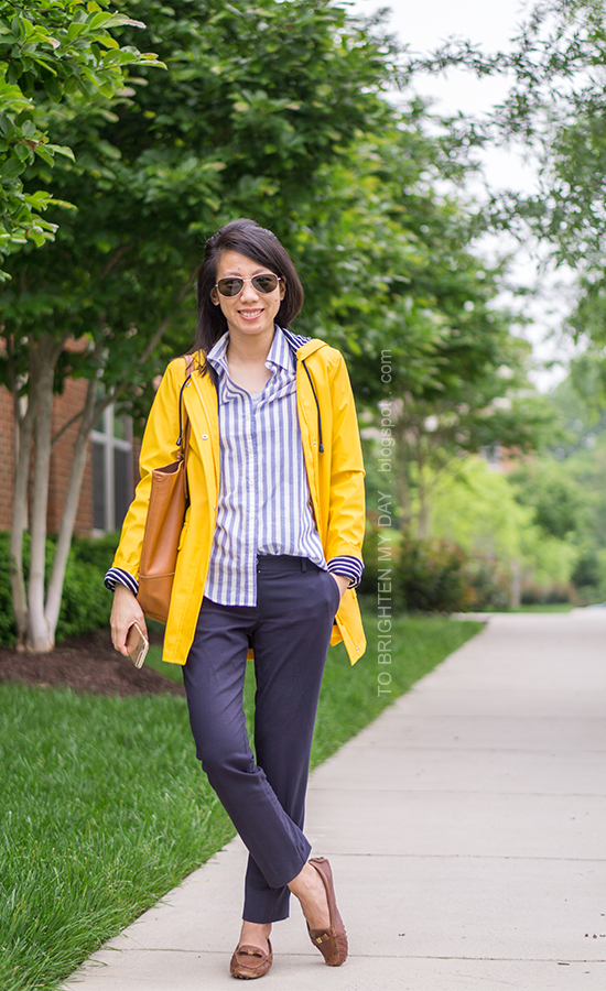 yellow rain coat, blue striped button up shirt, navy pants, cognac brown tote, brown loafers