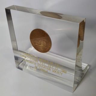 Lucite-encased Prince Edward Island cent