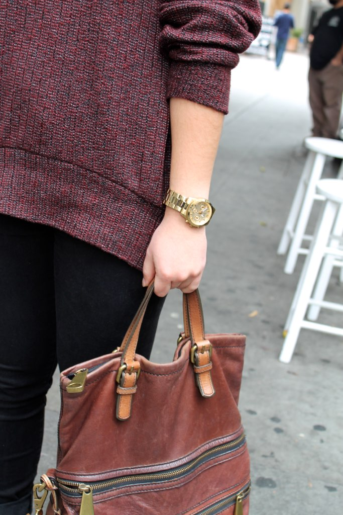 winter accessory details: gold watch + brown leather bag