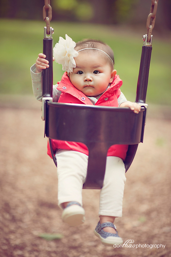 cute baby girl in swing - Hudsonville baby photographer