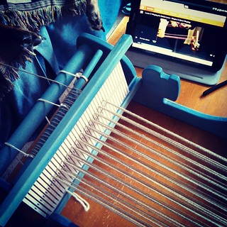 FINALLY... Learning how to assemble and warp my #Cricket #loom that I've had for a couple years now, thanks to a #Craftsy class! #weaving #instaweave #LetsDoThis Anyone notice the feet in background??