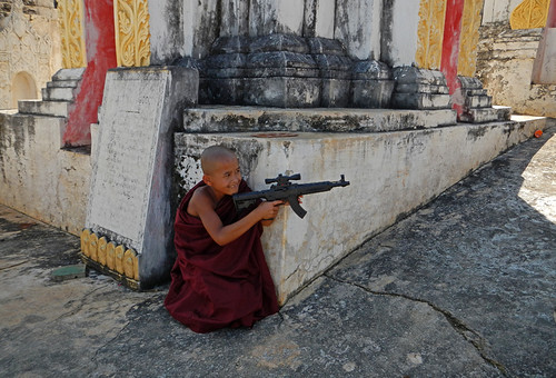 Little Monks Playing with Gun in the Temple